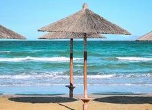 Parasols on the beach. Beach umbrellas at the beach Royalty Free Stock Photo