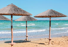 Parasols on the beach. Beach umbrellas at the beach Royalty Free Stock Photos