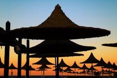 Beach umbrellas. Silhouette sunset Royalty Free Stock Photos