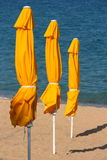 Beach umbrellas. Yellow umbrellas on the beach Royalty Free Stock Images