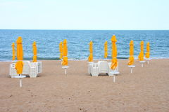 Beach umbrellas. Collapsed umbrellas on the beach Royalty Free Stock Images