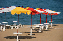 Beach umbrellas. Yellow umbrellas on the beach Royalty Free Stock Photography