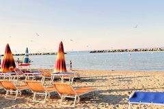 Beach. With umbrellas on the Adriatic sea in Italy stock photography