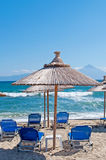 BEach with umbrellas and armchairs Royalty Free Stock Images