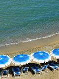 Beach umbrellas and beach chairs Stock Image