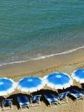 Beach umbrellas and beach chairs Stock Image