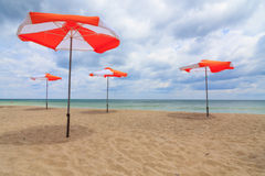 Beach umbrellas on the beach Stock Photo