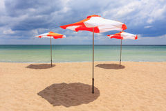 Beach umbrellas on the beach. With cloudy blue sky royalty free stock photography