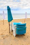 Beach umbrellas on the beach. With cloudy blue sky Stock Image