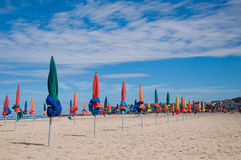 Beach umbrellas on a beach Royalty Free Stock Image