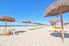 Beach umbrellas at the beach near the sea. Royalty Free Stock Image