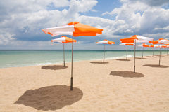 Beach umbrellas on the beach. Beach umbrellas on sand beach. Concept for rest, relaxation, holidays, spa, resort royalty free stock image