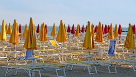 Beach umbrellas on the beach by the sea Royalty Free Stock Photography