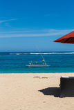 Beach umbrellas on a beautiful beach in Bali Stock Images