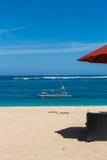 Beach umbrellas on a beautiful beach in Bali Stock Images