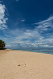 Beach umbrellas on a beautiful beach in Bali Stock Photo