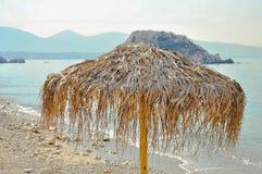 Parasol on the beach. Beautiful, palm beach  umbrellas at the beach Royalty Free Stock Image