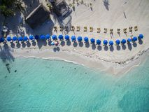 Beach Umbrellas on a Beautiful White Sand Beach - Aerial View. Aerial view of umbrellas and loungers on the beautiful white sand beach of Playa Norte on Isla Stock Photography