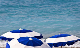 Beach umbrellas and blue sea Royalty Free Stock Photo