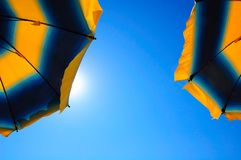 Beach umbrellas and blue sky Stock Photography
