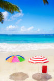 Beach umbrellas and chair by the ocean Stock Photography