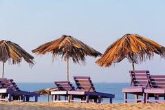 Beach umbrellas and chairs Stock Photo