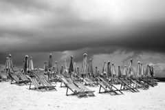 Beach umbrellas and chairs Stock Photos