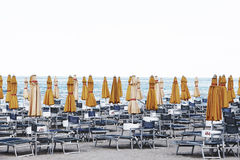 Beach umbrellas and chairs, bathhouse Royalty Free Stock Photos