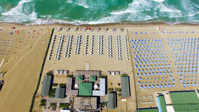 Beach umbrellas and chairs on the beach. Aerial bird eye view Stock Image