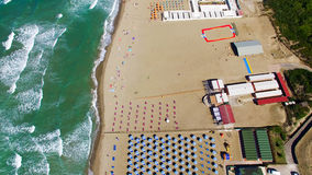 Beach umbrellas and chairs on the beach. Aerial bird eye view Stock Photography