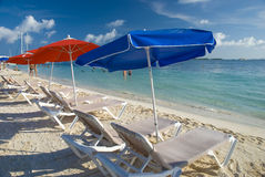 Beach umbrellas and chairs in Cancun, Mexico Royalty Free Stock Images