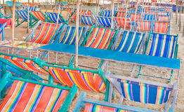 Beach umbrellas and chairs. Royalty Free Stock Images