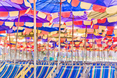 Beach umbrellas and chairs. Royalty Free Stock Image