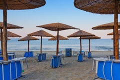 Beach umbrellas and chairs Stock Images