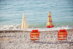 Beach umbrellas with chairs Stock Photos