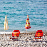 Beach umbrellas with chairs Stock Images