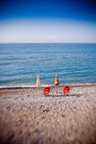 Beach umbrellas with chairs Stock Photography