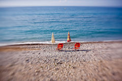 Beach umbrellas with chairs Stock Photo