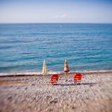 Beach umbrellas with chairs Royalty Free Stock Photography
