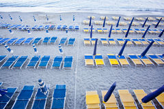 Beach umbrellas with chairs Royalty Free Stock Images