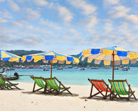 The beach umbrellas and deck chairs Stock Photo