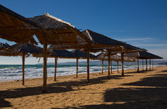 Beach umbrellas at the end of the season the sea Stock Photos