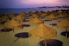 Beach with umbrellas at the evening Royalty Free Stock Images