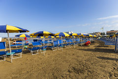 Beach with umbrellas at the first light of day in Italy Royalty Free Stock Photography