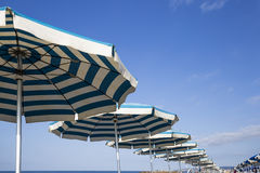 Beach with umbrellas at the first light of day in Italy Stock Image