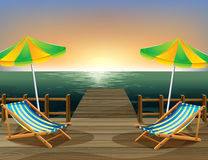 The beach umbrellas and the foldable chairs at the bridge Royalty Free Stock Photography