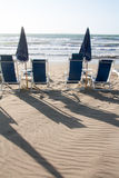 Beach umbrellas in front of the sea Royalty Free Stock Images