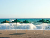 Beach umbrellas. In heavy weather Stock Photography