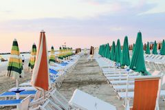 Beach. With umbrellas in Italy stock images