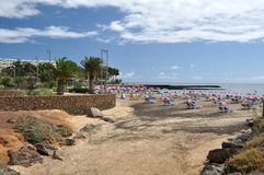 Beach with umbrellas, Lanzarote. Sandy beach with umbrellas in Costa Teguise Royalty Free Stock Image